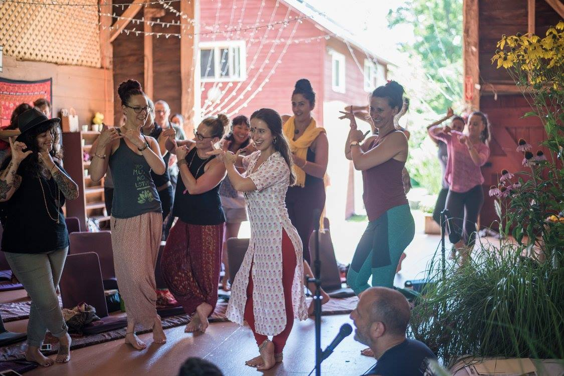 Photo of Bryn Chrisman dancing at the 5th Annual Bhakti Immersion Weekend