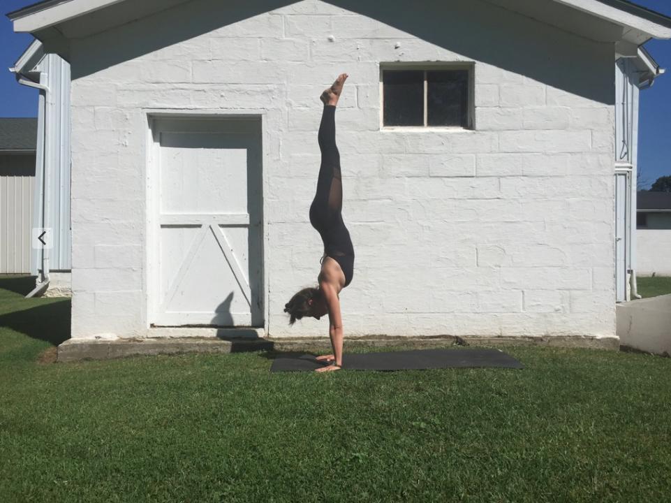 Image of yoga handstand Yogamaya