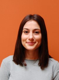 Headshot of Gina Benson, Yoga Teacher at Yogamaya